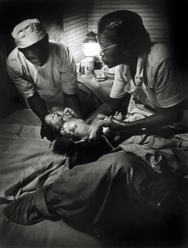 Nurse Midwife Delivering Baby, 1951 from  Nurse Midwife, Life Magazine  13 x 10 inches silver print