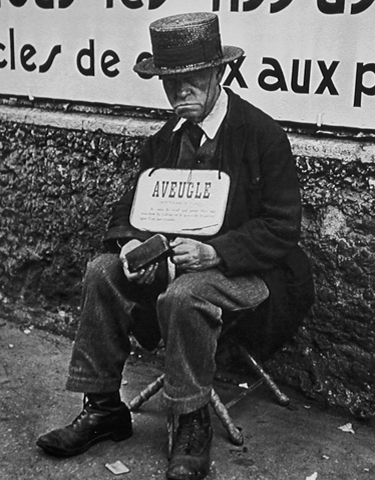 Blind Man in Front of Billboard, Paris, c.1933 20 x 16 inches silver print