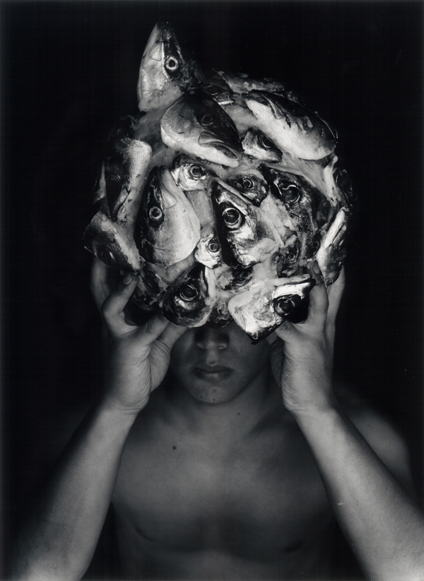 Sphere and Man , 1998  silver print  24 x 20 inches