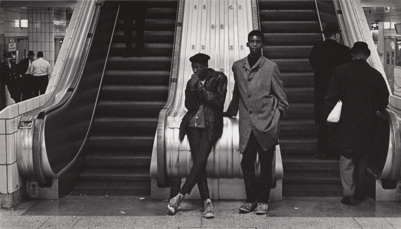Untitled (Two teens in front of escalator)   Vintage silver print  8 x 10 inches