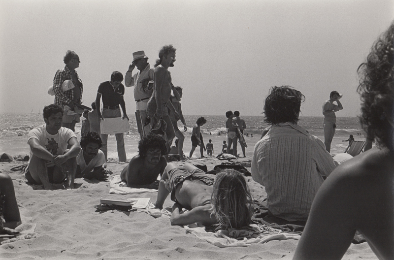 Untitled (Men looking at woman on beach) , c. 1970's  Vintage silver print  8 x 10 inches