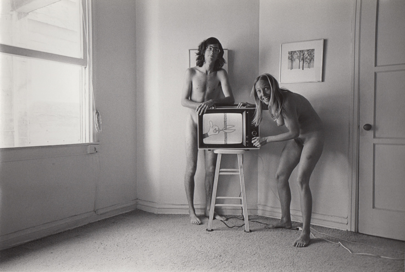 Ed Sievers   Untitled (man and women with tv) from People in My Corner, Venice, CA , c. 1970's Vintage silver print 8 x 10 inches