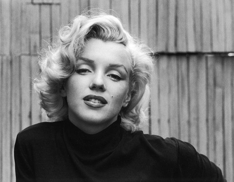 Alfred Eisenstaedt    Marilyn Monroe (Black Sweater Landscape) , 1953  Silver print  16 x 20 inches  Edition of 250
