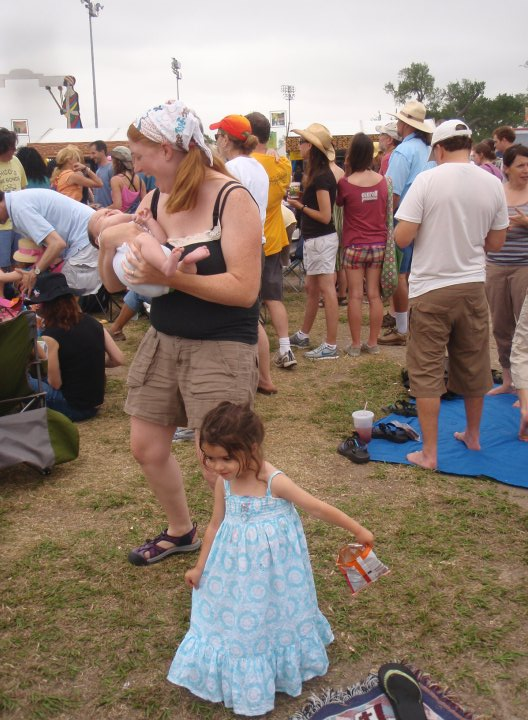 Just two months after baby number two.  My body is dancing at Jazz Fest, keeping up with my toddler and nourishing my baby. My hair was shedding so I didn't wear it down freely to keep myself from being covered in hair.