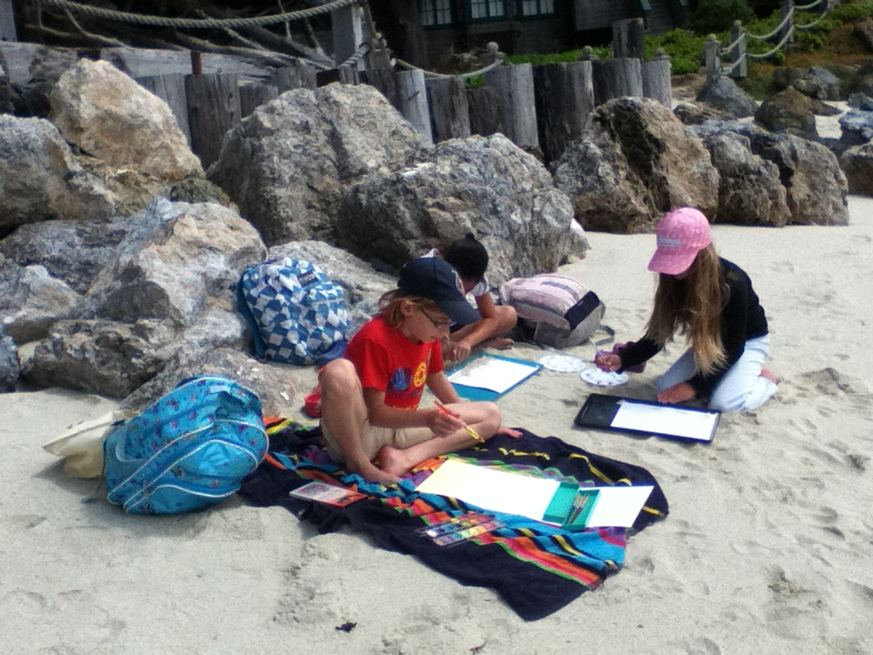 Paint with your friends at the beach.