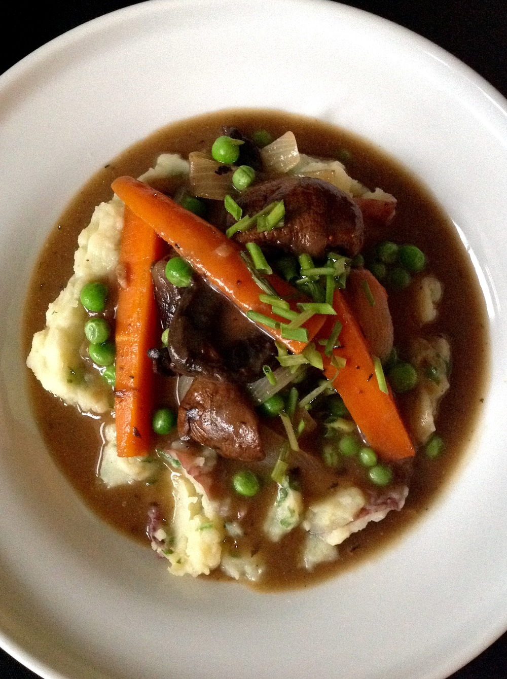 Hearty Belgium Mushroom Stew over Smashed Red Potatoes