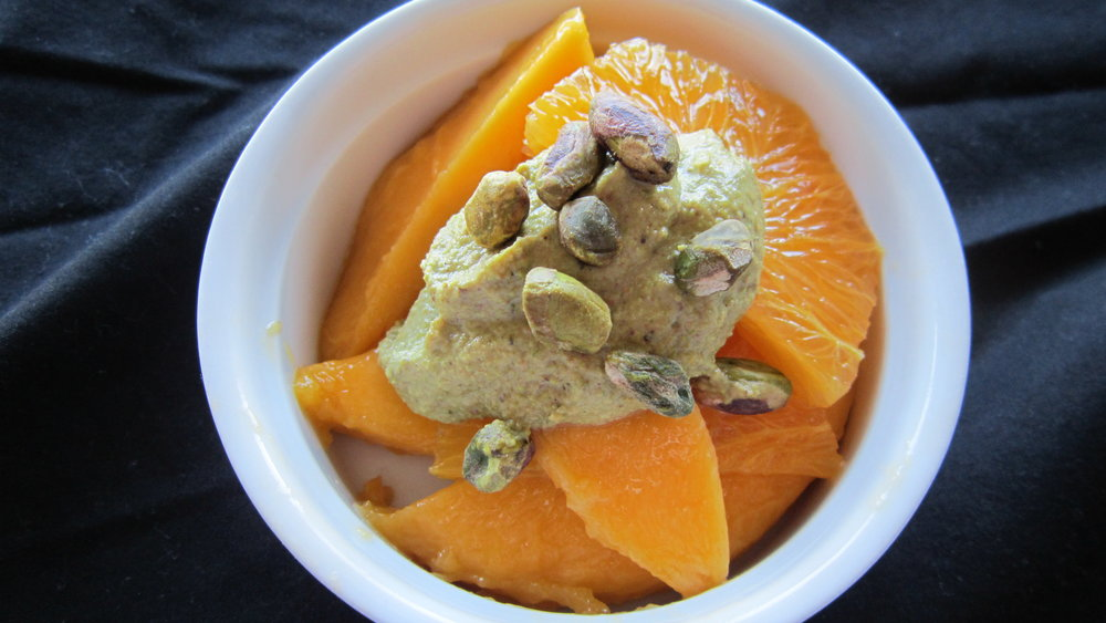 Pistachio Cardamom Cream with Fresh Orange and Mango Slices