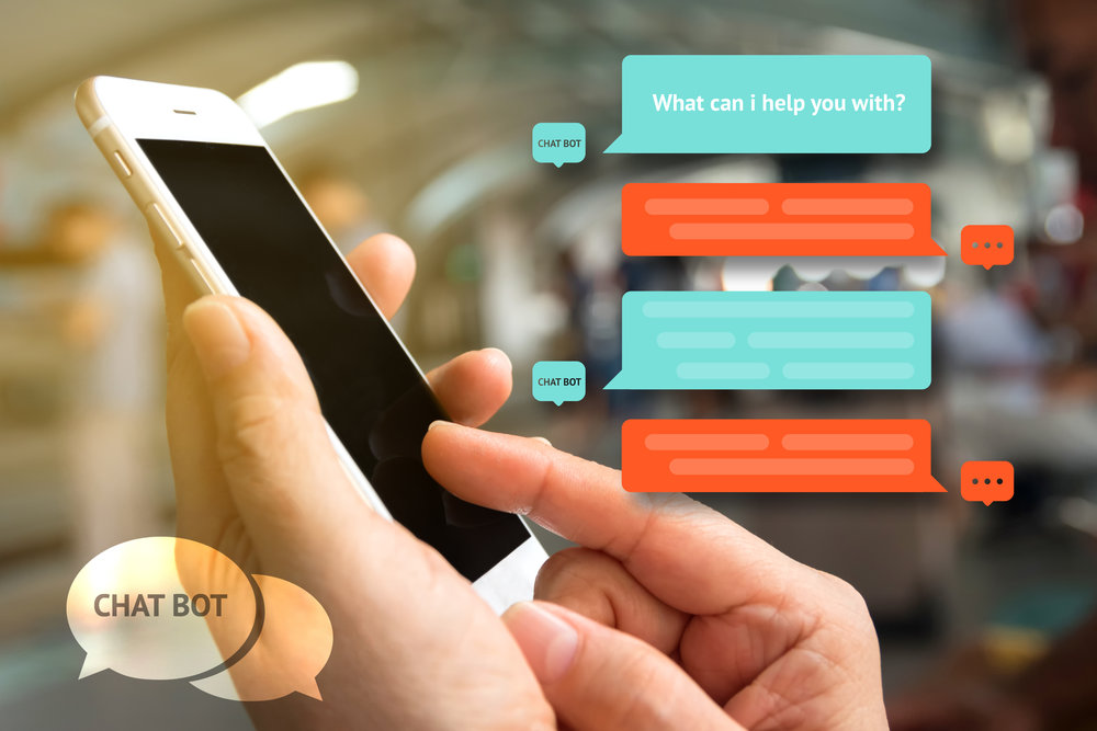 Chat bot and future marketing concept , Chatbot icon , Hand holding mobile phone with automatic chatbot message screen with abstract background
