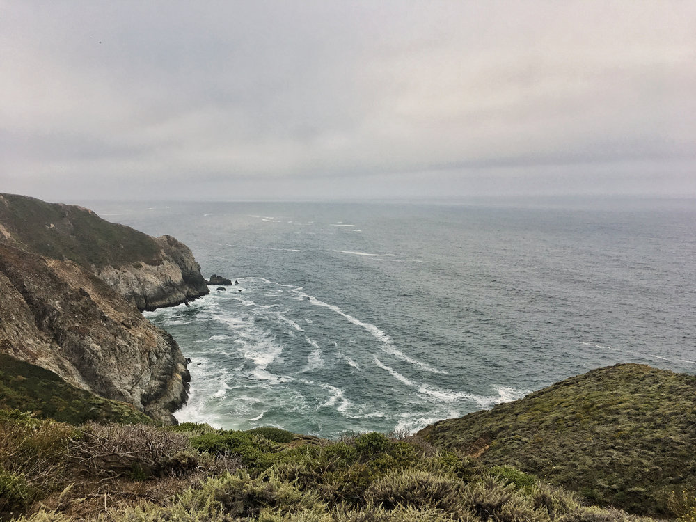 the pacific ocean washes against the coastline on a chilly morning ride. Pacifica, CA