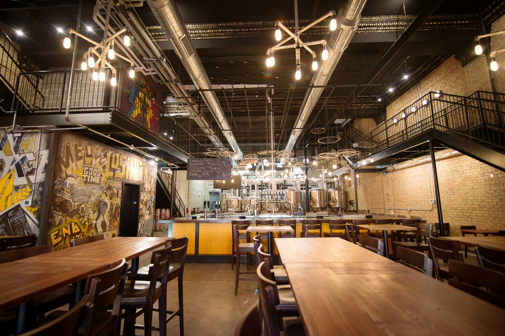 LynLake Brewery in Uptown, Minneapolis features high ceilings, graffiti-like art, and a large taproom that accommodates up to 130 guests.