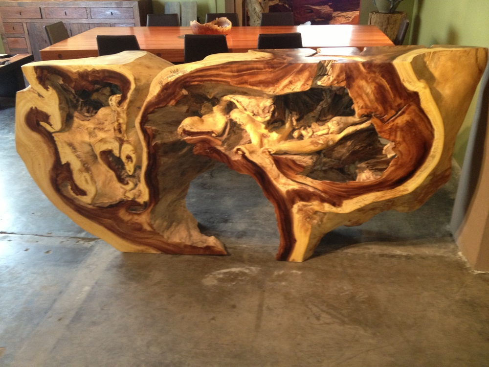 This is a magnificent table made in Thailand of reclaimed monkey wood.