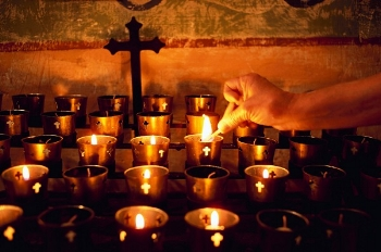 All-Souls-Day-Lighting-Candles.jpg