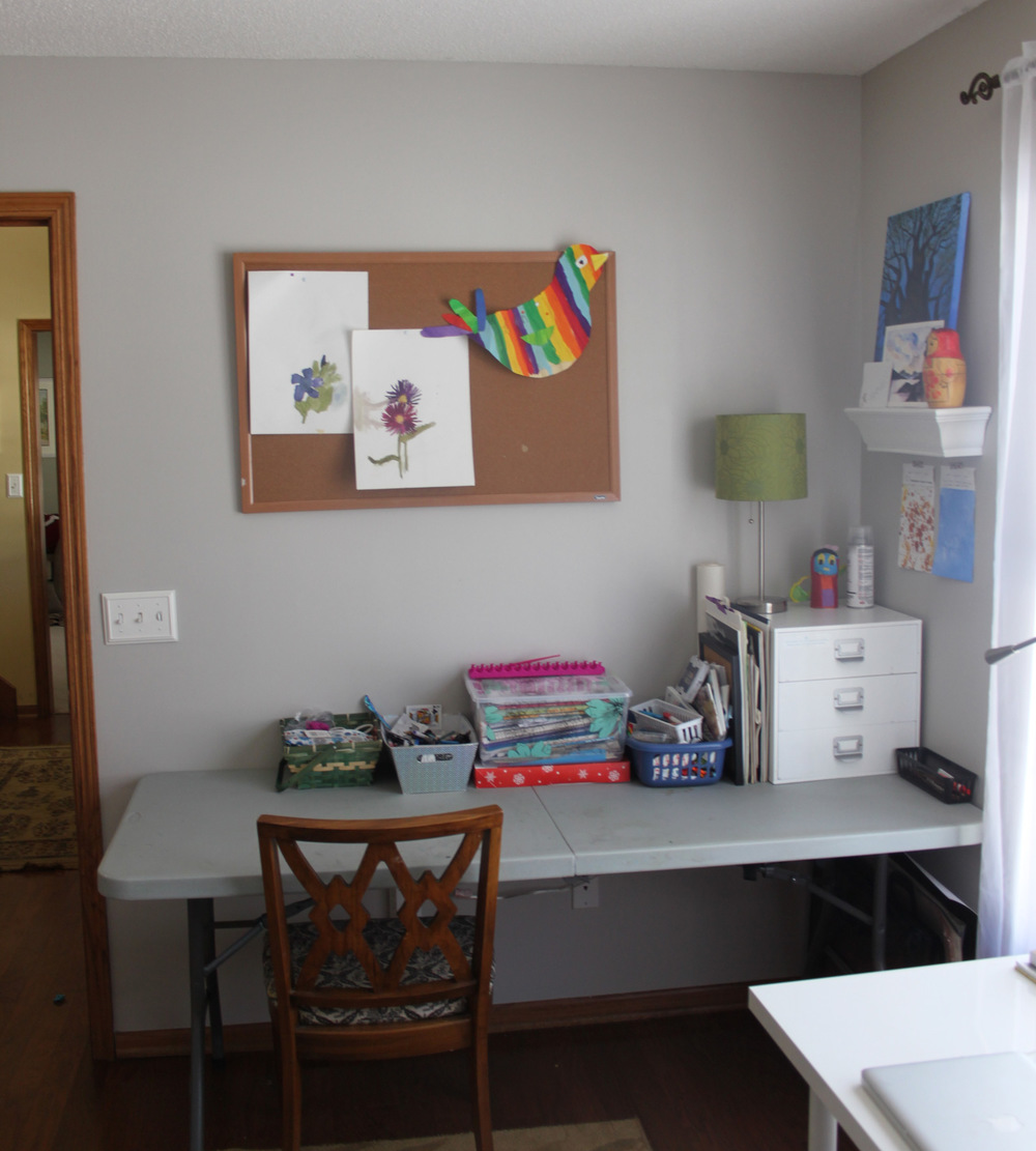 The kids' space. I'll probably paint that bulletin board this summer. I love having an old folding table in here that can be colored and painted and spilled on.