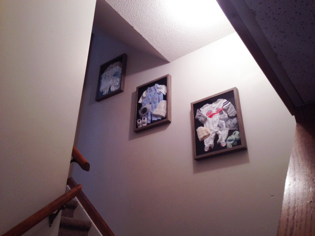 Here they are on the wall which leads down to the basement playroom. It's been bare for two years. Another reason not to wait one more second! Even though I had lots of other things needing to be done. ;)