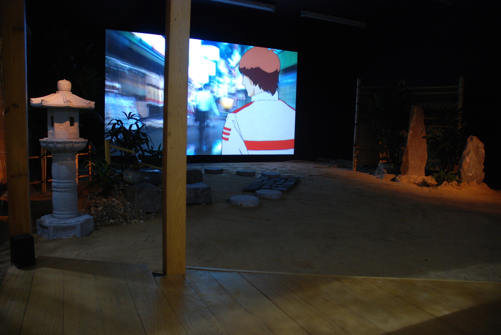Installation view of film projection and Japanese garden seen from the tea house