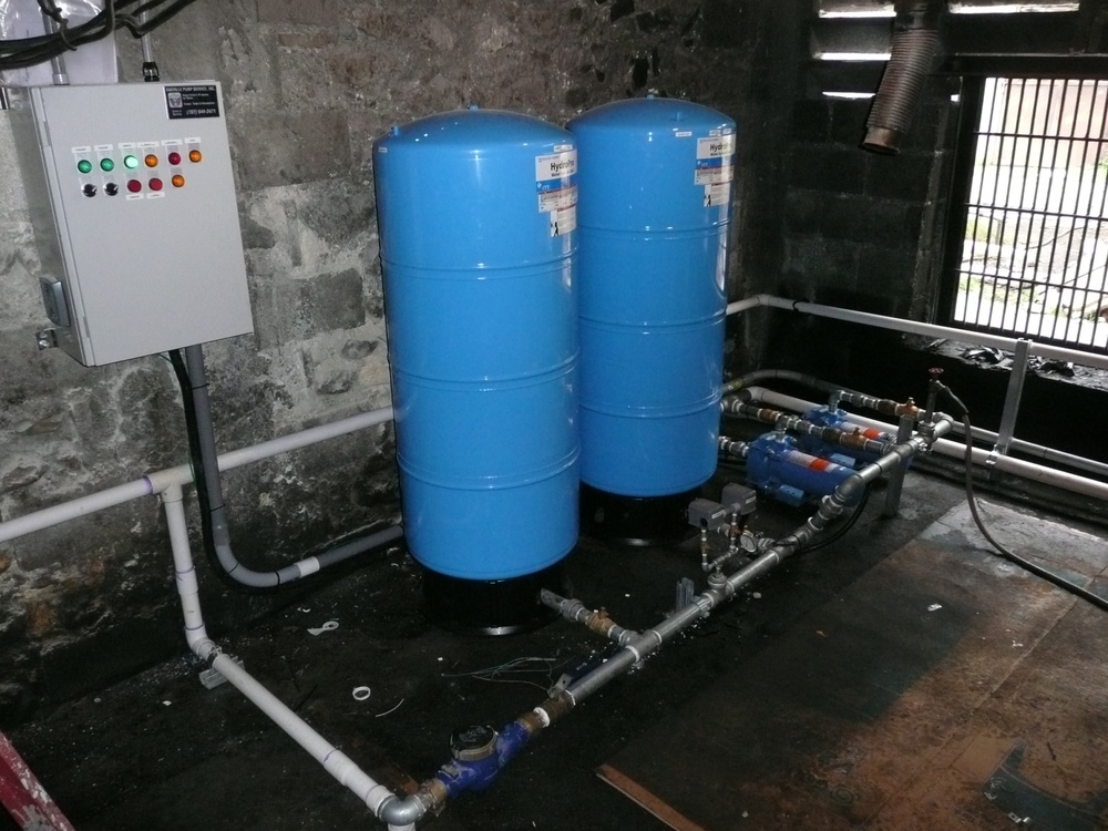 Redundant pumping system for pure water at Hopital Adventiste d'Haiti in Port-Au-Prince.