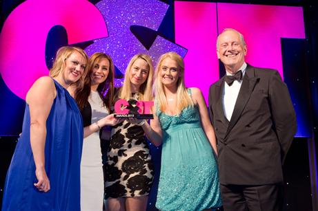 Jennifer, Alex, Jo and Hollie collecting the award at the London ceremony from host Giles Brandreth