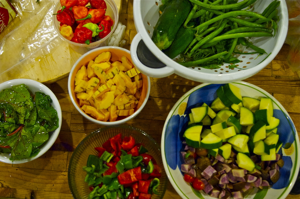 summer's abundance: mise en place of delicata squash, chard, green beans, zucchini's, habanero peppers, purple potato + bell peppers
