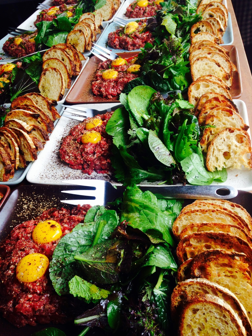 A Feast of Lamb Tartare with Bitter Greens and Crustini