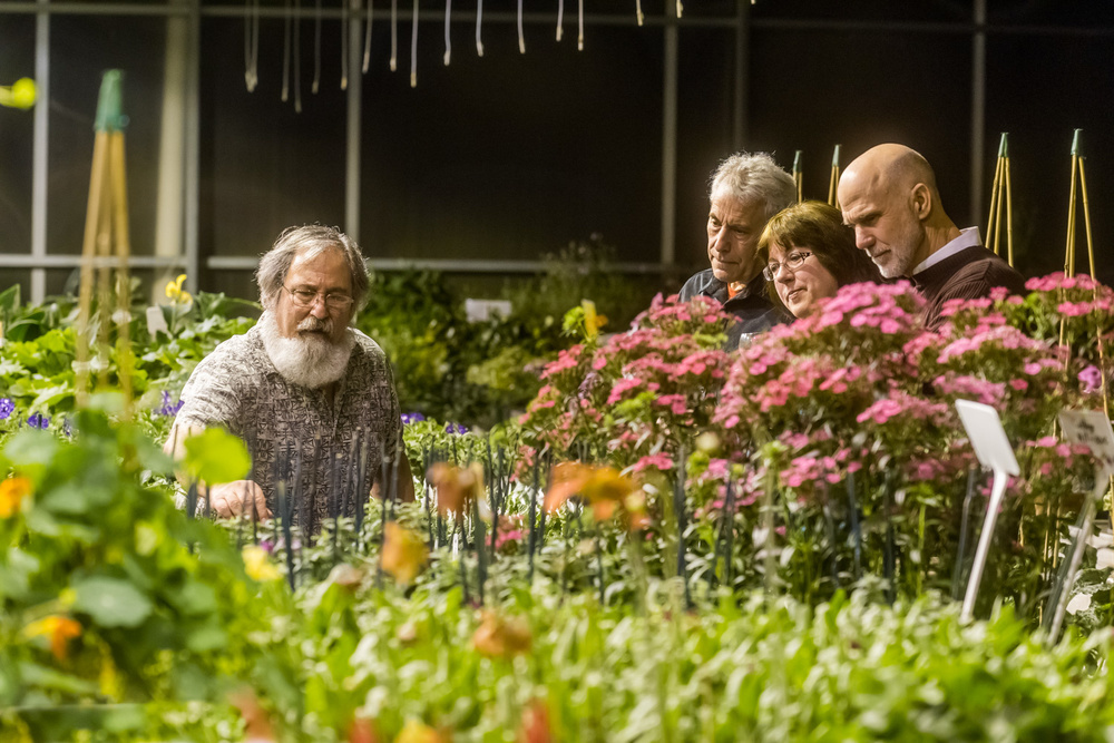 Lloyd Traven showing guests the greenhouses// Photo by James Bassett-Cann