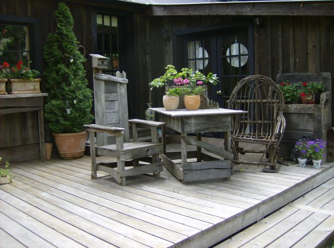 antique chairs and dock treated with LifeTime wood treatment.jpg