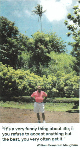 Trina's dad outside of his childhood home in July 2003 with the single palm tree.