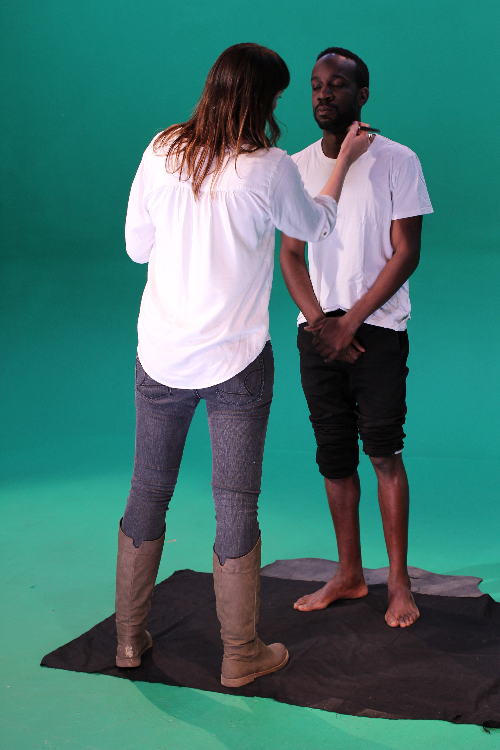"""David Kibuuka getting made up for his """"poverty"""" campaign shoot"""