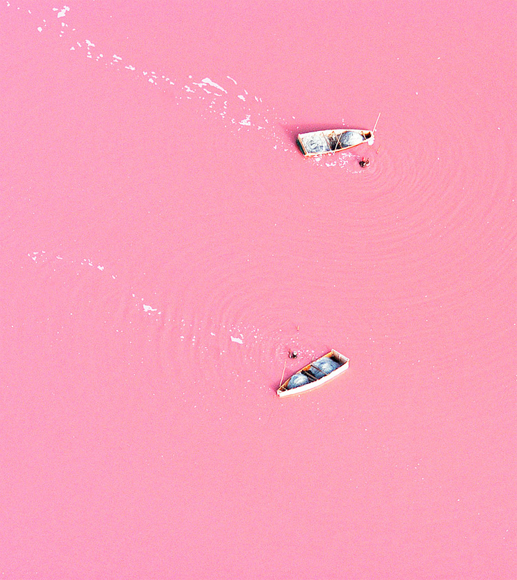 Aerial photograph of salt-collecting boats on Lake Retba, Senegal.