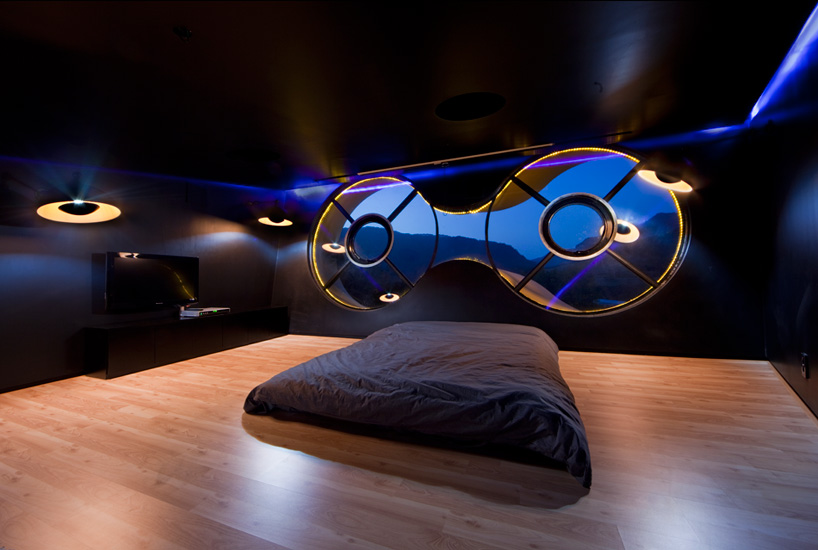 The bedroom of 'Stealth Black' contains two round windows that reframe the landscape.