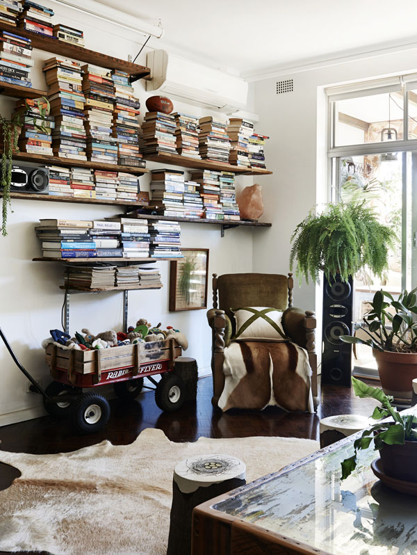Living room. Pony rider x cushion , banjos toy box made from vintage radio flyer. Photo –  Eve Wilson.  Production – Lucy Feagins/The Design Files.