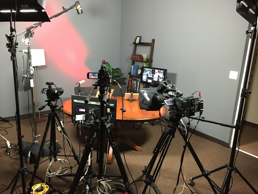 Three camera set up with tally lights, lighting, and studio monitor.