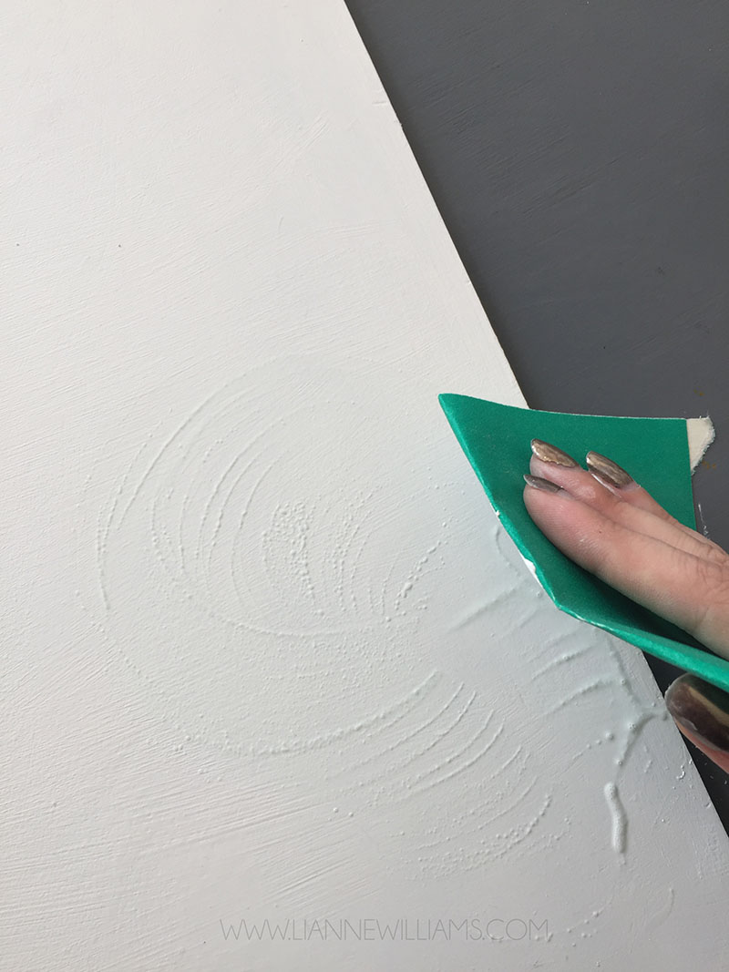 Smoothing gesso with water