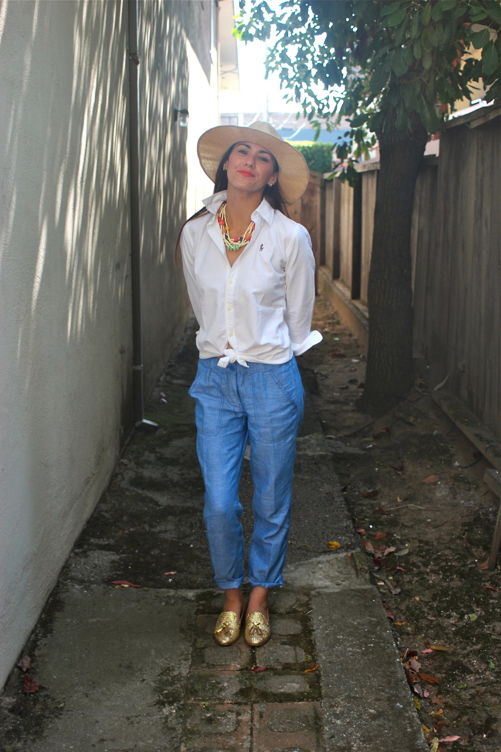 Hat: Sway ; Shirt: Ralph Lauren; Pants: J.Crew; Shoes: Prada; Necklace: Vintage, circa 1980s