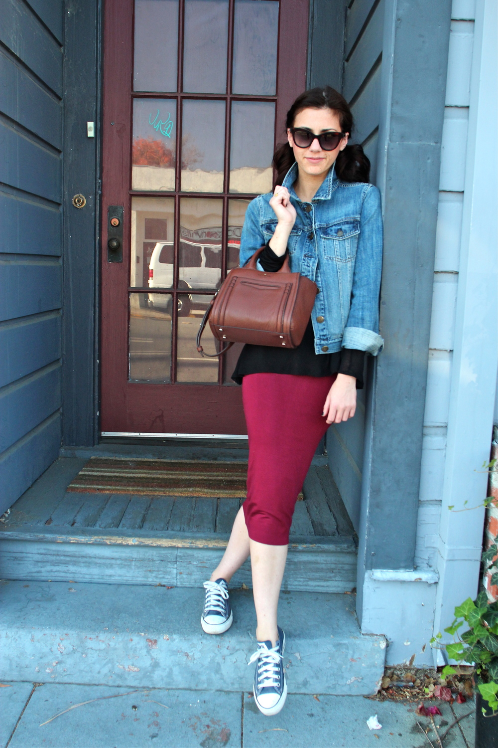 Top: Babaton, Artizia; Denim Jacket: J.Crew; Skirt: Leith, Nordstrom;  Bag: Kate Spade, Nordstrom ; Sneakers: Converse; Sunnies: Marc by Marc Jacobs