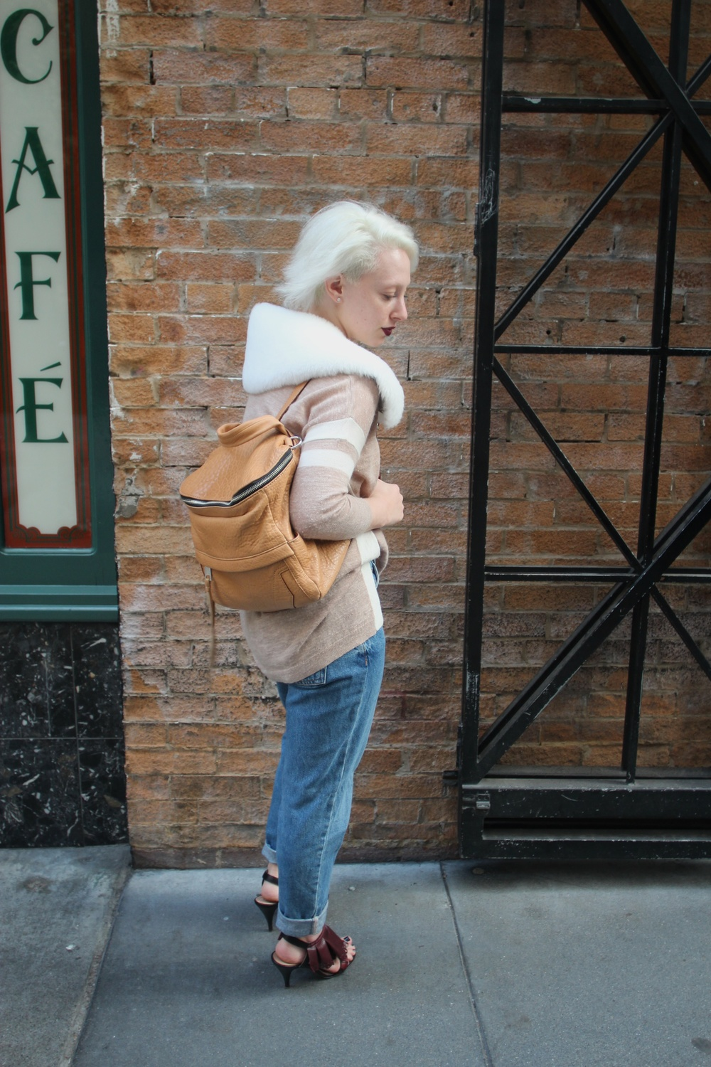 "Sweater: J.Crew, Denim: Topshop ""Mom Jean"", Shoes: Nina Ricci, Backpack: Rebecca Minkoff, Shearling Epaulette: The Podolls"