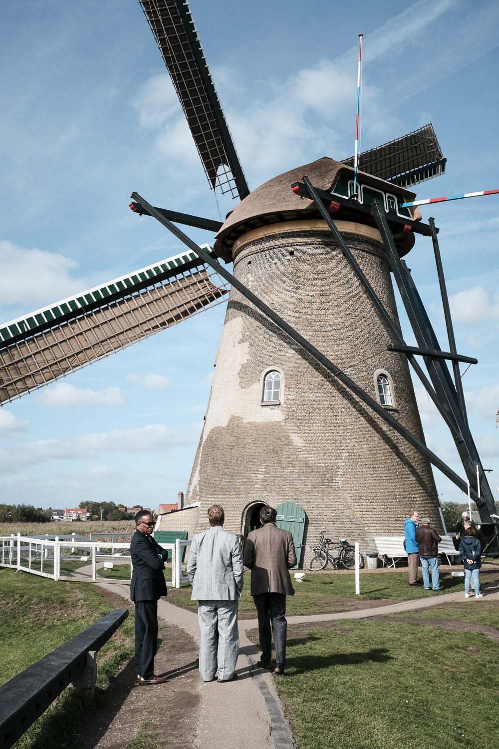 Council-members Dudley Gregorie and Michael Seekings observe a windmill at the Kinderjink World Heritage Site with Winslow Hastie, CEO of Historic Charleston Foundation