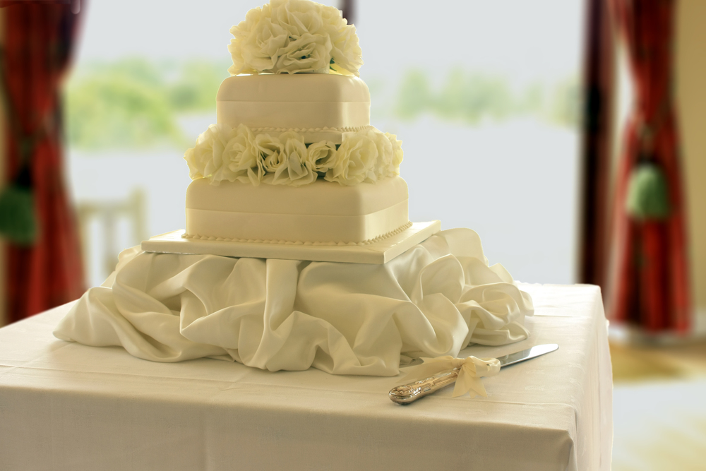 Beautiful white satin cake with floral details; Event by Washington DC event planner Christine Masney on Fortique