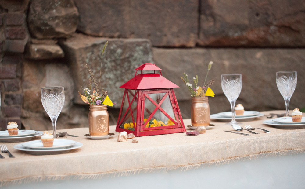 Bronzed mason jars, red painted lantern, rustic, country table setting; Event styled by Washington DC event planner Darian and Dechele Events on Fortique
