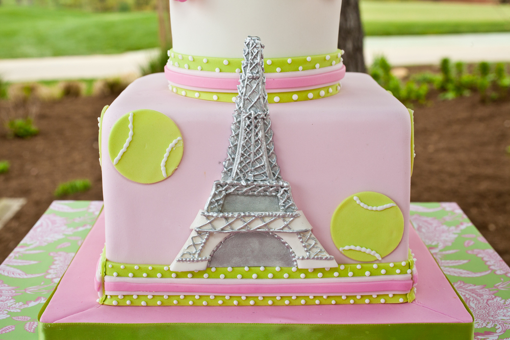Eiffel tower, pink and green, tennis themed birthday cake; Pink and green bubblegum favors for girls tennis themed birthday party; Event styled by Washington DC event planner Petite Social on Fortique
