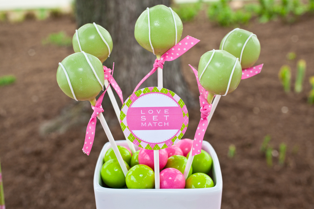 Green tennis ball cake pops; Pink and green bubblegum favors for girls tennis themed birthday party; Event styled by Washington DC event planner Petite Social on Fortique