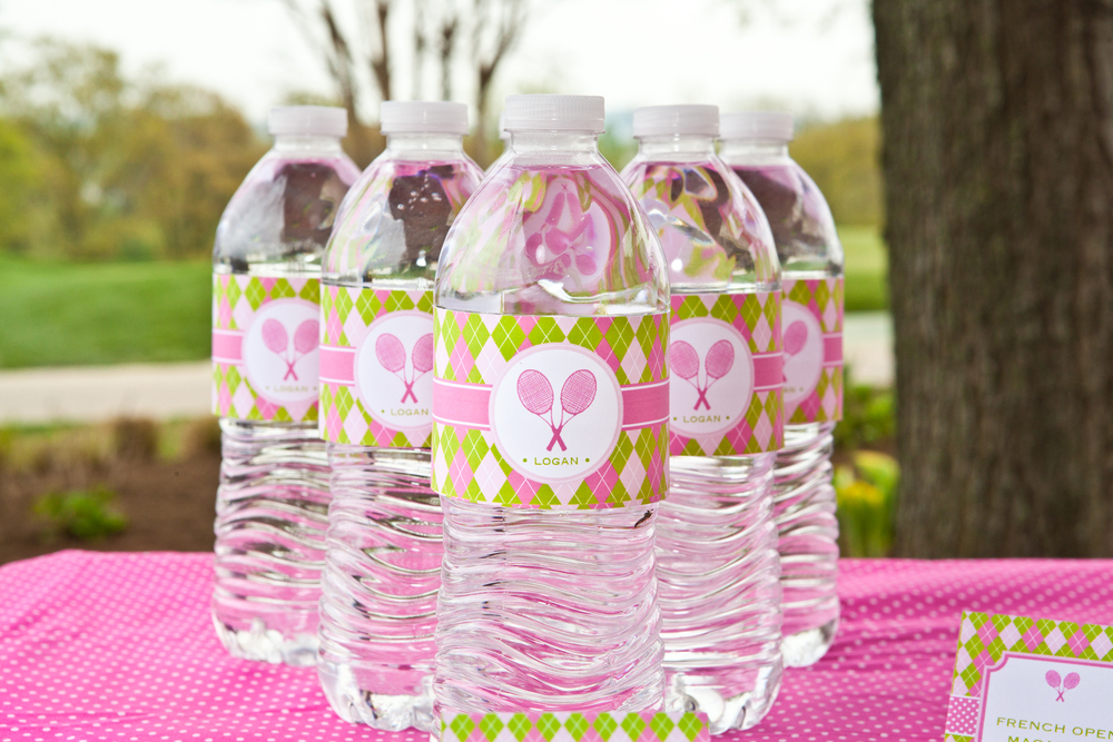 Dress up water for a girls tennis themed birthday party; Pink and green bubblegum favors for girls tennis themed birthday party; Event styled by Washington DC event planner Petite Social on Fortique
