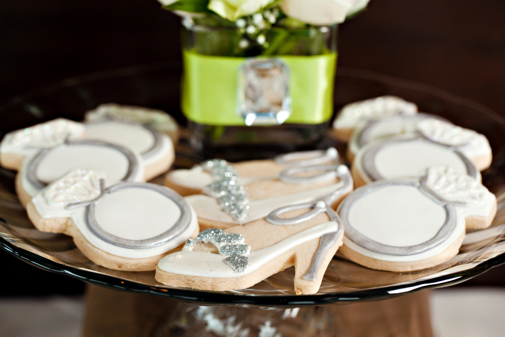 Engagement ring and Jimmy Choo shoe cookies; Green and tan Jimmy Choo-inspired engagement brunch; Event styled by Washington DC event planner Petite Social on Fortique