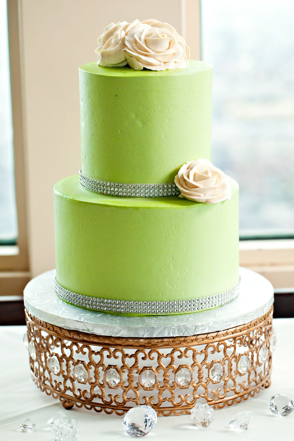 Green cake with cream roses; Jimmy Choo-Inspired engagement brunch; Event styled by Washington DC event planner Petite Social on Fortique