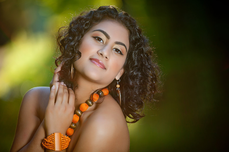 Bold, orange, editorial makeup with gold and orange eyeshadow and rose lip; makeup makeup by top Washington DC makeup artist Brigid Wilson on Fortique