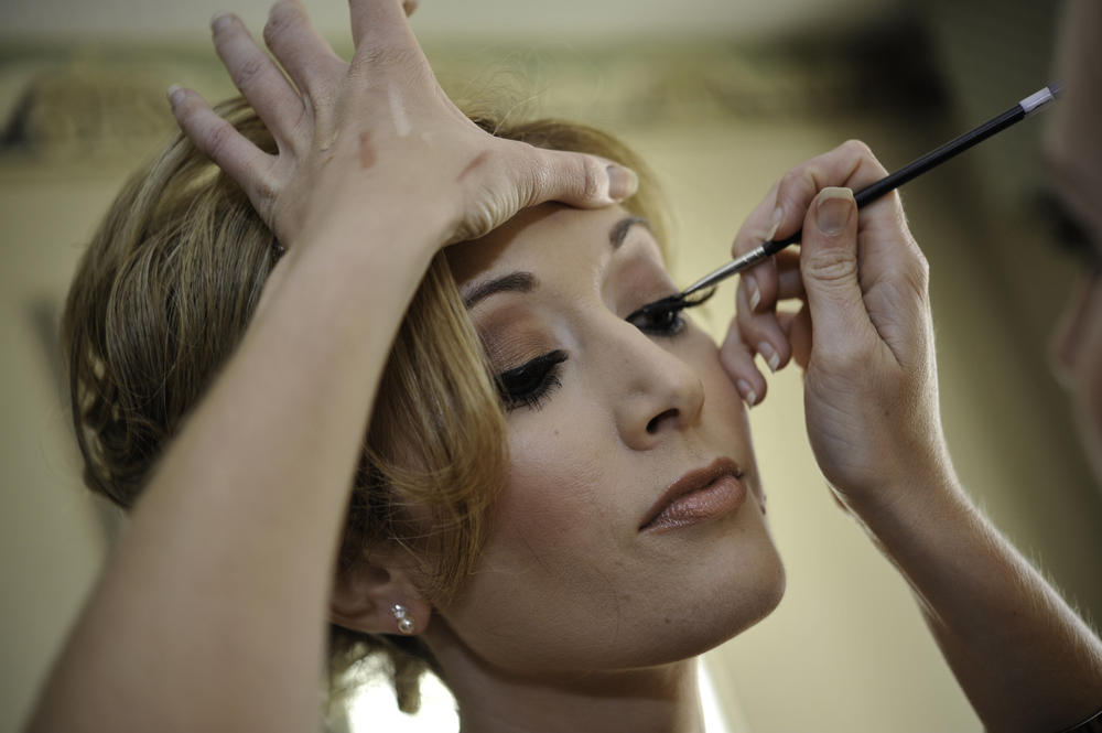 Bold and dramatic bridal makeup with black eyeliner, full lashes, neutral lip; wedding makeup by top Washington DC makeup artist Brigid Wilson on Fortique