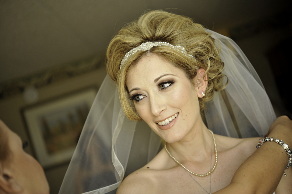 Glam and bold wedding makeup for blonde with updo and beaded headband; wedding makeup by top Washington DC makeup artist Brigid Wilson on Fortique