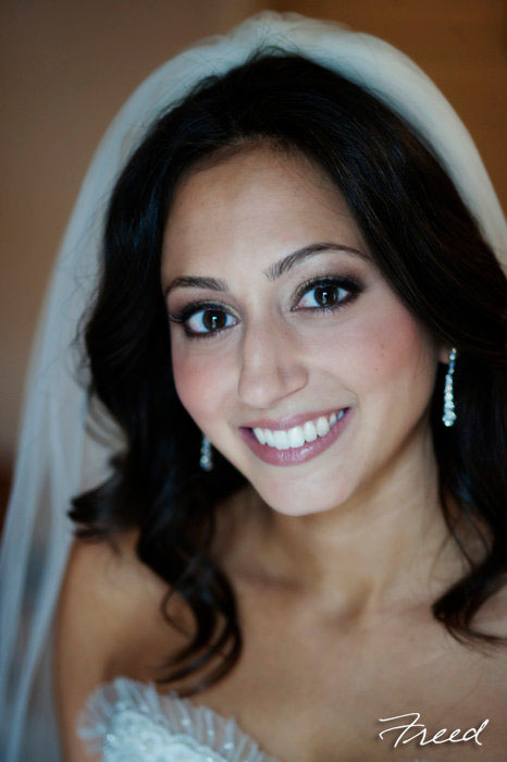 Bold eye, full lashes, bridal makeup for dark brown hair; makeup by Washington DC wedding makeup artist Stacy Ferguson on Fortique