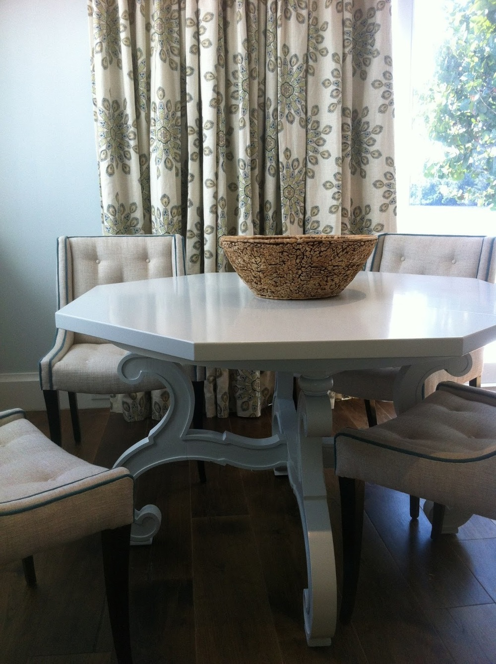 Gorgeous breakfast table with cream canvas chairs designed by Washington DC interior designer Decor Dose on Fortique