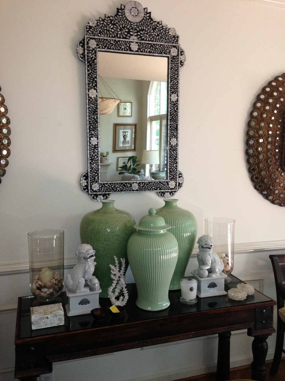 Entrance way with green vases, ornate mirror, miniature statues; Designed by Washington DC interior designer Decor Dose on Fortique