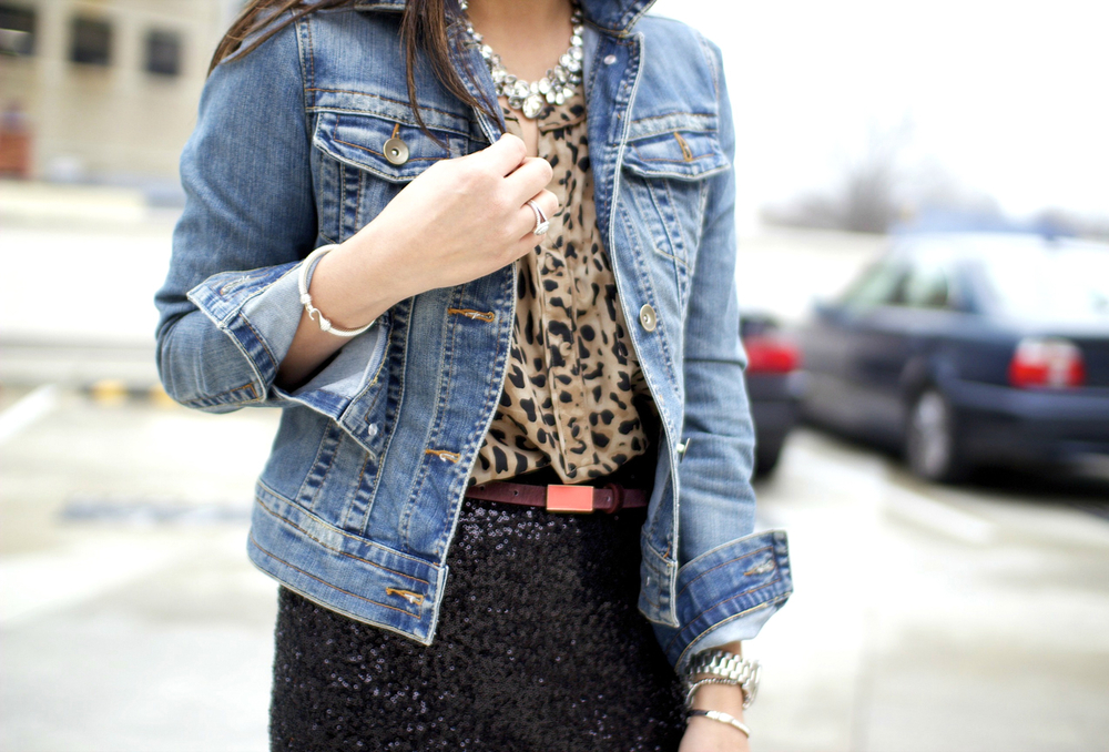 Casual daytime look featuring light blue jean jacket, leopard print top, sequin skirt, accent belt styled by top Washington DC stylist Naina Singla on Fortique